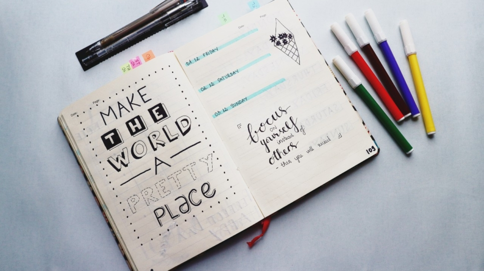 A picture of a bullet journal with neat printing and calligraphy
