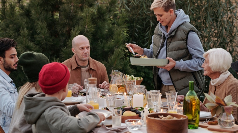 A family shares an outdoor meal.