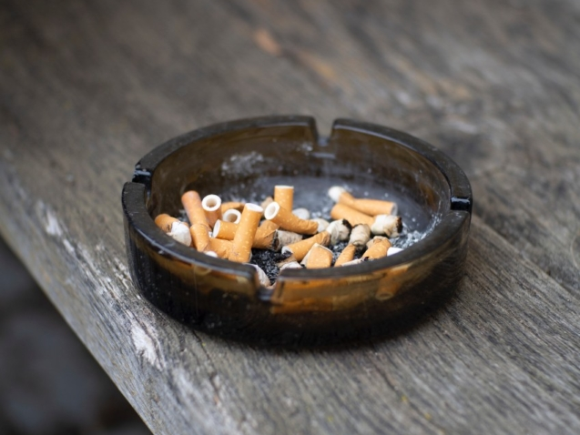 A picture of a full ashtray, a habit that needs to be broken